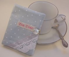 This tea wallet makes me think of tea at Downton Abbey.  pale grey polka dot and lace tea wallet by MyPetitBisous on Etsy