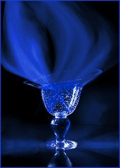 Sapphire blue smoke in a glass.