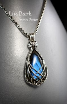 Beautiful blue Labradorite cab in a criss cross wire wrap.  If you'd like to learn this, you sure can.  Here is the link to the tutorial:  https://www.etsy.com/listing/156274277/criss-cross-pendant-tutorial?ref=shop_home_active_4