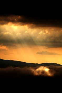 """♂ amazing nature golden sun rays through the dark brown could """"Battle of clouds and sun on the Earth"""" by farshid alizadeh"""