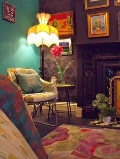 i love the colors and funky mix of styles in this room.. reminds me of a house i used to live in