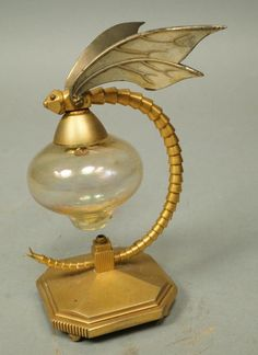 Vintage Dragonfly Perfumer Perfume Bottle. Gilt metal dragonfly with amber glass bottle. Possibly French or Czech. Uniques & Antiques Auctions