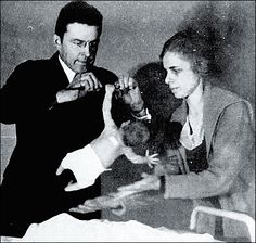 Dr John B. Watson and Rosalie Raynor studying the grasp reflex of a newborn baby. Baltimore. ca 1916-1920. - Are you kidding me?