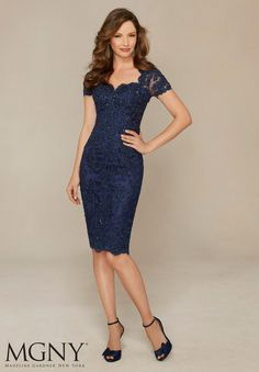 Evening Gowns and Mother of the Bride Dresses by MGNY Beaded Lace Appliqués on Net Colors: Navy, Silver, Teal.