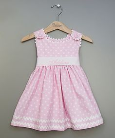 This breezy little dress features a high waist, coordinating sash and covered button shoulder closures. It's perfect for parties, picnics or pictures and can be personalized with the name of the sweetie who's wearing it.  Shipping note: This item will be personalized just for you. Allow extra time for your special find to ship.