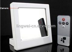 Hidden Spy Camera Mirror - SEE THE WORLD'S BEST COVERT HIDDEN CAMERAS AT http://www.spygearco.com/mini-clock-cameras.php