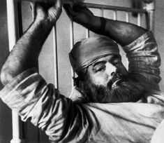Robert Capa © International Center of Photography GREAT BRITAIN. London. May, 1944. Ernest Hemingway in a hospital bed.
