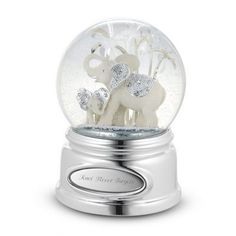 Personalized Beaded Elephant Snow Globe Gift by Things Remembered. $34.99. Elephants are symbols of wisdom in Asian cultures and revered for their intelligence and memories. She'll never forget how much you care about her when she reads what you engraved on this charming water globe that features a snuggling mom and baby elephant. Both elephants shine with beaded silver detailing on their ears, while the globe rotates and plays Born Free.-Elephant bodies feature an artisan...