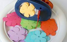 "DIY kids craft: using Fiskars ""Poppy Burst"" punch to prep for lei necklaces"