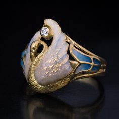 French Art Nouveau Swan Motif Enamel Ring, France, circa This unique, one-of-a-kind Art Nouveau era gold ring is centered with a delicate swan whose wings are covered with pale bluish pink ( Art Nouveau Ring, Art Nouveau Design, Art Nouveau Jewelry, Jewelry Art, Antique Jewelry, Vintage Jewelry, Art Deco, Jewelry Design, Vintage Rings