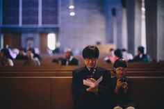 The photographer captured this unexpected moment from the front of a church. This is a good illustration of real photojournalism. The subjects are completely unaware of the photographer and maybe even of each other—they're in their own worlds. Technology is reshaping the way we interact with those around us. Photograph by Tommy Seo | National Geographic