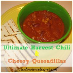 Ultimate Harvest Chili with Cheesy Quesadillas- Delicious chili recipe with ground turkey, kidney beans, bell peppers and pumpkin puree. This is a MUST TRY chili and the cheesy quesadillas are the perfect pairing on cold fall and winter nights.