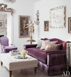 Would never know this is Kelly Wearstler it's so subdued. The touches of purple in the custom sofa and chair give this room an air of femininity.