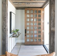 """door is a custom solid stain grade wood door with a translucent black stain and clear glass with an anodized aluminum threshold.  Door Hardware: Hardware is Emtek """"Mormont"""" entry set in black finish."""