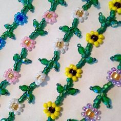Daisy Chain Choker by BeadleBoo on Etsy Seed Bead Patterns, Beaded Bracelet Patterns, Beading Patterns, Beaded Bracelets, Daisy Chain, Beaded Crafts, Jewelry Crafts, Diy Collier, Art Perle