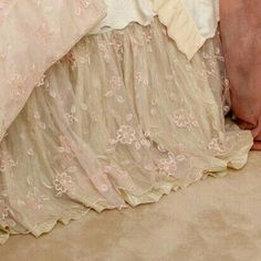 love the bed skirt out of it looks like wedding lace. awesome!
