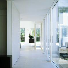 Garden: Corridor Modern Single House Design With Ceramic Floor Tiles Glass Window And White Interior Color Decorating Ideas