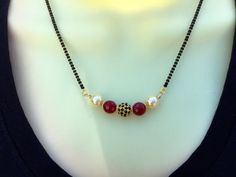 Black Stone Studded Mangalsutra Red Beads Mangalsutra by Alankaar
