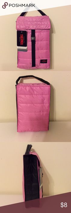 Thermos insulated lunch bag NWT thermos lunch bag. Pink on the front and back and black on the sides. Clip strap closure. Insulated. Size 7.8 x 3.2 x 11.2 inches. Thermos Bags