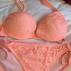 Bikini Coral bikini. Worn a couple times. Medium in juniors Xhilaration Swim Bikinis