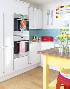 Bright Family Kitchen with Turquoise Metro Tiles and Yellow Vintage Table