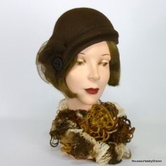 Dark brown felt cloche with vintage buttons, crin, and cording by SHARON PANOZZO #millinery #Hats #HatAcademy