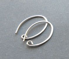 Oval Ear Hooks- These oval ear hooks are made with 20 gauge wire and hammered on one side flat. These wires were also tumble polished for added strength and shine. For a similar ear hook design, these wires measure at 19-20mm (¾ inch) long and 13 mm wide.