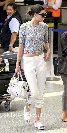 Seen on Celebrity Style Guide: Kendall Jenner wearing the Topshop Space Dye Knit Sweater as she touched down at LAX after their trip to New York and Paris July 10....  Get Kendall's Outfit: http://rstyle.me/~2emBV