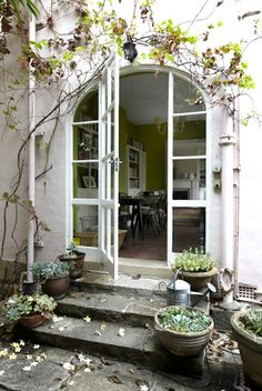 Arched door entrance with white exterior and potted plants design Decorating at Home with Pink Interior Exterior, Exterior Design, Exterior Doors, Rustic Exterior, Beautiful Space, Beautiful Homes, Entrance Doors, Arch Doorway, Garden Entrance
