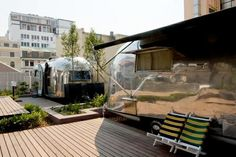 Rooftop Airstream Hotel:  The Airstream Penthouse Park sits atop the historic Grand Daddy Hotel in the middle of Cape Town, South Africa. It features seven trailer suites, each designed by local artists, as well as a bar and lounge area.
