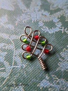 Christmas tree wire craft $happy hands Try it with beads and pipe cleaner??