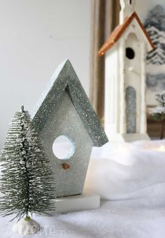 A thrifted winter wonderland made from Goodwill birdhouses and glitter, does it really get any better?!