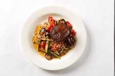 Tenderloin of Beef, Shiitake, Asparagus, Tomato, Farro, Buttered Mushroom Soy Sauce by D'Amico Catering, via Flickr