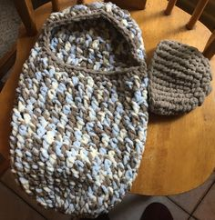 Hooded Baby Cocoon: I used Bernat Baby Blanket yarn, Little Cosmos. Beanie was made using Bernat Blanket Yarn, Baby Sand. You can purchase the Coccon pattern at Etsy: https://www.etsy.com/listing/79640682/download-pdf-crochet-pattern-s004?ga_order=most_relevant&ga_search_type=all&ga_view_type=gallery&ga_search_query=pattern%20s004&ref=sr_gallery_1