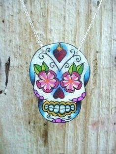 vintage tattoo style dia de los muertos (day of the dead) sugar skull with flowers and sacred heart necklace! Want it!