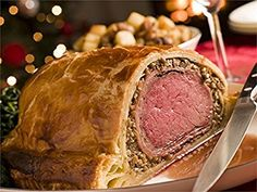 """Kentucky Beef Wellington.  from Kentucky's Best: Fifty Years Of Great Recipes.  This recipe featuring Maker's Mark bourbon comes from from """"That Special Touch"""" by Sandra Davis.  Preheat over to 425 degrees. Put tenderloin on rack in shallow roasting pan. Bake uncovered for 25 to 30 minutes. Remove from oven and let stand 30 minutes. Mix liverwurst spread, mushrooms, and bourbon. Set aside....  http://www.farmersmarketonline.com/k/KentuckyBeefWellington.html"""