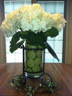 Cinco De Mayo Hurricane from www.imagine.willowhouse.com.  A simple yet elegant centerpiece for a Cinco De Mayo event. I used the Galveston Hurricane with white hydrangeas and limes. Love the color combination of white and lime green together. Use and inner vase to help hold the limes in place and fill with water to keep the limes fresh.