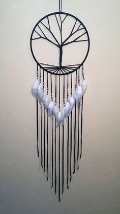 Instead of regular loops, this one is designed like the branches of a tree (like another one mentioned before). It's sleek looking especially with the strings and feathers hanging.
