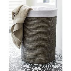 Shop Sedona Black Hamper with Liner. Handwoven rattan, finished in black, crafts a tall, roomy cylinder, lidded to keep laundry or used towels out of view. Washable cotton canvas liner has a drawstring closure and carrying strap. Dorm Organization, Home Decor Baskets, Laundry Hamper, Laundry Room, Chic Bathrooms, New Home Designs, Warm Grey, Bathroom Storage, Bathroom Ideas