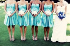 Aqua strapless bridesmaids dresses and white bridesmaid bouquets