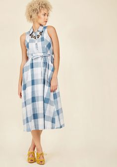 <p>Bring back pretty pastoral style with present-day conviction by simply stepping out in this plaid midi dress! Crafted from cotton, tied 'round the waist, and perfectly pocketed for charm and convenience, this blue and white shirt dress breathes new life into looks both nostalgic and serene.</p>