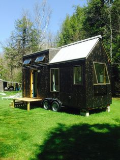 This unique looking tiny house on wheels sports a unique appearance thanks to the black exterior and whitewashed insides. Built on a wide trailer, it clocks in at . Read Black & White Tiny House With A Dash Of Color Tiny House Swoon, Tiny House Plans, Tiny House On Wheels, Tiny Houses For Sale, Little Houses, Tiny House Exterior, Black Exterior, Rustic Exterior, Tiny House Listings