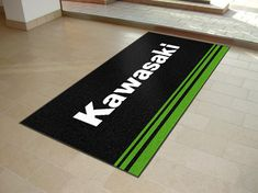 Printed Logo Floor Mats supplied to Kawasaki dealerships.  Pantone colour matching used to match brand guidelines.