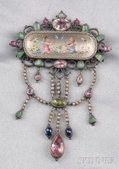 Antique Silver, Enamel, and Gem-set Pendant/Brooch, the polychrome enamel scene depicting winged putti at play, in an elaborate frame suspending drops set with various colored stones and split pearls, 2 3/8 x 3 1/2 in