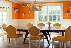 Orange    A dining room in bright orange proves that citrus has an refined side. By keeping the furniture and accessories restrained and elegant, this room is as formal as any done in navy or dark green.      Tip: A matching dining set is not a rule to live by. Pairing a dark wood table with gleaming white painted chairs allows each to shine in its own right.
