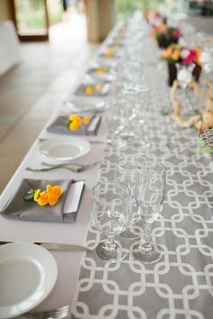 A modern print makes a perfect table runner Photography by Swoon by Katie / swoonbykatie.com, Event Planning   Floral Design by I Do…Weddings