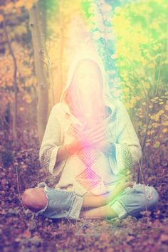 Receive Light Woman experiencing a natural high meditating in the forest.