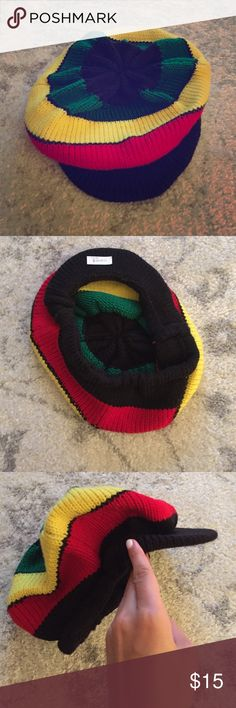 Authentic Jamaican rasta hat This handmade, bought in Jamaica, billed cap has a black brim and then a band of rasta colors. One size fits most. This hat has never been worn. The crown is approximately 10 inches. Accessories Hats