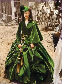 The ultimate green ensemble is the dress Scarlett makes from green velvet curtains.  The curtain dress was originally designed by Walter Plunkett and it was sold at an auction in Beverly Hills  for $137,000.