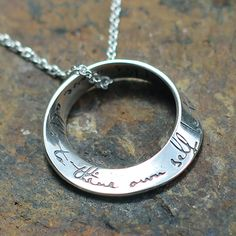 """Sterling silver mobius necklace inscribed with """"This above all: to thine own self be true."""""""